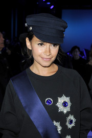 Miroslava Duma added flair to her look with a blue captain's cap when she attended the Elie Saab fashion show.