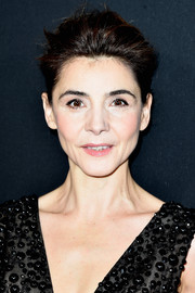 Clotilde Courau styled her hair into a pompadour for the Elie Saab Couture Spring 2015 show.