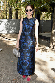 Araya A. Hargate made an appearance at the Elie Saab fashion show wearing a blue and black printed maxi dress.