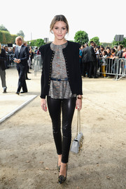 Olivia Palermo looked perfectly put together in a fitted black jacket, a print blouse, and leather pants at the Elie Saab fashion show.