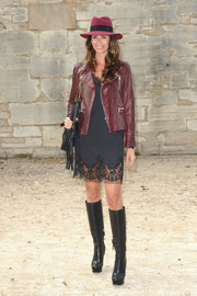 Christina Pitanguy added an extra dose of toughness with a pair of black knee-high boots.