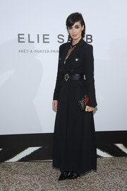 Paz Vega styled her coat with a flower-detailed box clutch.