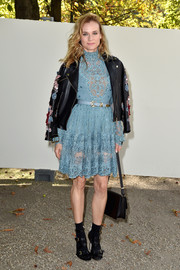 Diane Kruger sported some funky footwear at the show--a pair of buckled strappy sandals which she wore with black socks.