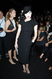 The always elegant Dita styled her dress with a hat.