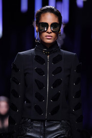 Cindy Bruna looked cool wearing these oversized square sunglasses on the Elie Saab runway.