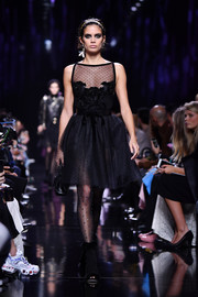 Sara Sampaio was a classic beauty in a Swiss-dot LBD while walking the Elie Saab runway.