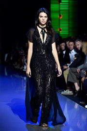 Now that's a cool jumpsuit!  Kendall Jenner walks for Elie Saab in floor-length sparkles.