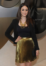 Emmy Rossum teamed her metallic skirt with a bronzed statement necklace full of intricate beading.