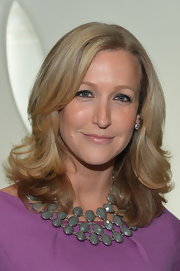 Lara Spencer added some contrast to her bright purple dress with a muted gray collar necklace at the Fall 2013 Elie Tahari runway show.
