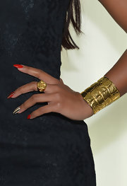 Eve showed her bold and cool style with a chunky gold cuff bracelet at the Elie Tahari Fall 2013 runway show.