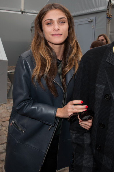 Elisa Sednaoui Red Nail Polish [clothing,outerwear,hairstyle,leather,fashion,leather jacket,long hair,overcoat,layered hair,jacket,winter 2012,outside arrivals,elisa sednaoui,ready-to-wear fall,part,paris,louis vuitton,paris fashion week womenswear fall,paris fashion week,show]