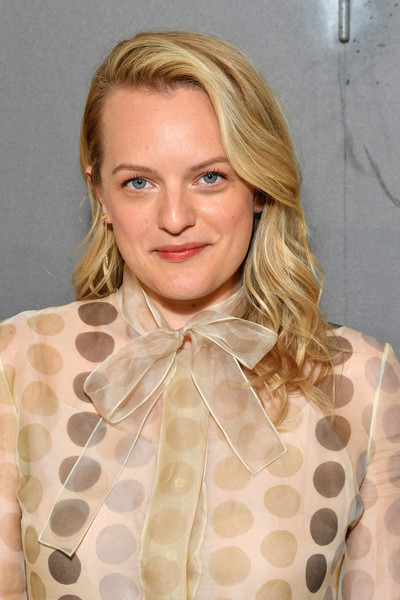 Elisabeth Moss Long Wavy Cut [haute couture fall,hair,face,blond,hairstyle,lip,eyebrow,beauty,chin,polka dot,neck,christian dior,elisabeth moss,part,paris,france,christian dior haute couture fall,photocall - paris fashion week,paris fashion week,show]