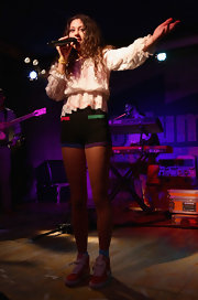 Eliza wears colorful 80's short shorts for her performance in Milan.