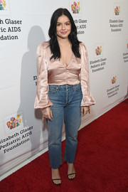 Ariel Winter topped off her jeans with a blush satin blouse.