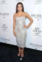 Eva Longoria paired her ultra-chic dress with embellished pink sandals by Alaia.