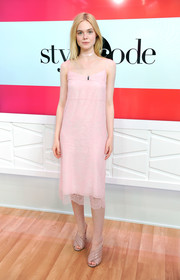 Elle Fanning opted for comfy nude mules by Gucci to finish off her look.