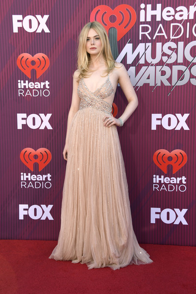 Elle Fanning Cutout Dress [dress,clothing,red carpet,carpet,gown,premiere,hairstyle,shoulder,flooring,fashion,arrivals,elle fanning,iheartradio music awards,california,los angeles,microsoft theater,fox]