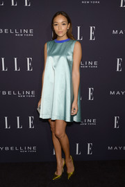 Ashley Madekwe added an extra punch with a pair of metallic chartreuse snakeskin pumps by Jimmy Choo.