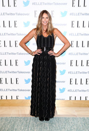 Elle MacPherson looked ageless in a sleeveless black maxi dress with white trim while attending a dinner at Twitter AU HQ.