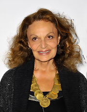 Diane von Furstenberg showed off a bronzed coin necklace while hitting Elle magazine's 25th anniversary party. she completed her look with her signature bouncy curls.