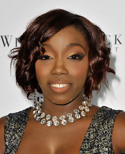 Estelle completed her winning look with a diamond collar necklace, which was the perfect accessory fr her ensemble.