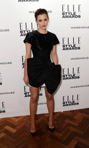 Emma Watson turned heads once again at the Elle Style Awards in a Giambattista Valli Couture LBD with a beaded bodice and an architectural skirt.