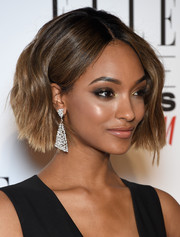 Jourdan Dunn finished off her look with a pair of triangular chandelier earrings by Messika Joaillerie.