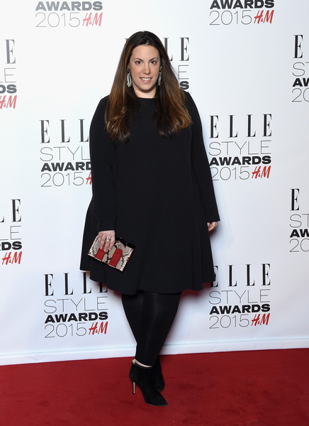 Mary Katrantzou sealed off her all-black outfit with a pair of ankle boots.