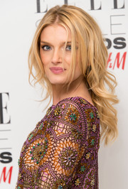 Lily Donaldson looked romantic with her flowy, center-parted waves at the Elle Style Awards.