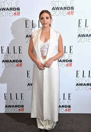 Elizabeth Olsen stood out in a sea of dresses in her long white Calvin Klein silk vest during the Elle Style Awards.