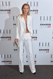 Toni Garrn donned a Western-inspired fringed pantsuit for the Elle Style Awards.
