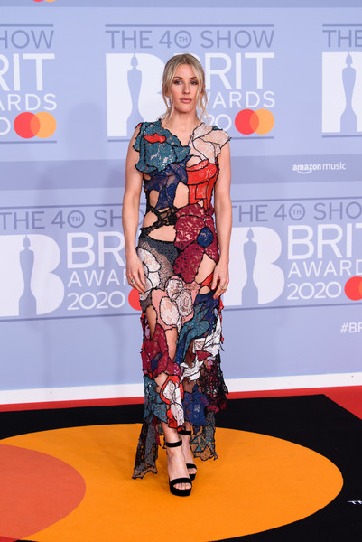 Ellie Goulding Sheer Dress [red carpet,carpet,clothing,fashion,flooring,dress,yellow,fashion design,premiere,event,red carpet arrivals,ellie goulding,brit awards,england,london,the o2 arena,the brit awards 2020,ellie goulding,celebrity,red carpet,2020 brit awards,fashion,lookbook,platform sandals,model,socialite,shoe]