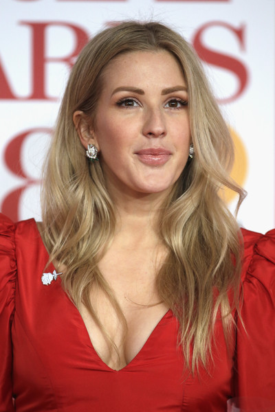 Ellie Goulding Long Wavy Cut [hair,blond,hairstyle,long hair,layered hair,eyebrow,beauty,chin,brown hair,lip,red carpet arrivals,ellie goulding,brit awards,relation,the o2 arena,england,london]