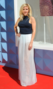Ellie Goulding attended the opening of the British Designers Collective wearing a high-neck blue tank top with square armholes.