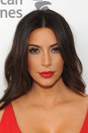 Kim Kardashian totally brightened up her beauty look with this lovely red lip color.