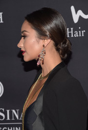 Shay Mitchell paired her lovely updo with dazzling gemstone chandelier earrings by H. Stern.