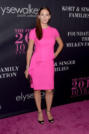 Jennifer Garner lit up the Pink Party with this neon-hued peplum dress by Christian Dior.
