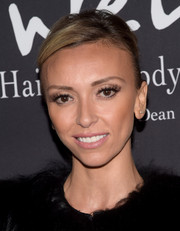 Giuliana Rancic pulled her hair back into a casual updo for the Pink Party.
