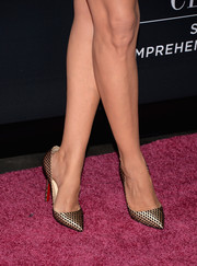 Paz Vega stepped out on the magenta carpet in an ultra-stylish pair of fishnet-patterned gold Louboutin pumps during the Pink Party.