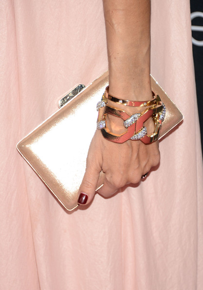 Rachel Zoe lightened up for a change with this metallic pink clutch and pink dress combo at the Pink Party.
