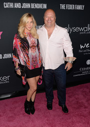 Michelle Chiklis finished off her look in edgy style with a pair of black ankle boots.