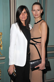 Emmanuelle Alt held on to a classic black and gold clutch as she attended a dinner in honor of Michael Kors.