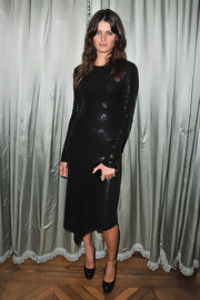 Isabeli donned a sequin satured LBD with long sleeves and an A-symmetrical hem for the Michael Kors show in Paris.