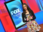 "'Shameless' star Emmy Rossum attended a taping of ""Fox & Friends"" wearing an 18-karat gold modern Rock Candy multi-stone ring in purple haze."