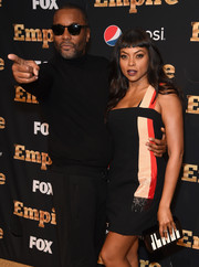 Taraji P. Henson attended the 'Empire' season 2 premiere carrying a cute piano clutch by Les Petits Joueurs.