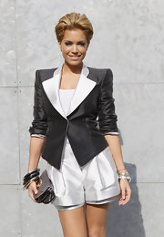 Sylvie van der Vaart added chunky silver bangle bracelets that worked great with her modern look.
