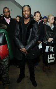 A$AP Rocky rocked a classic leather coat at the En 1 Noir Presentation during 2013 Fall Fashion Week.