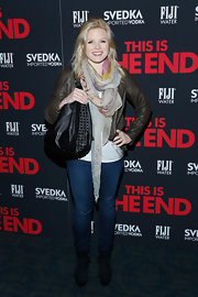 Megan Hilty chose a dark green leather jacket for her look at the premiere of 'This is the End.'