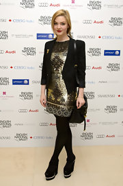 Holliday Grainger matched her outfit with a pair of sky-high wedges.