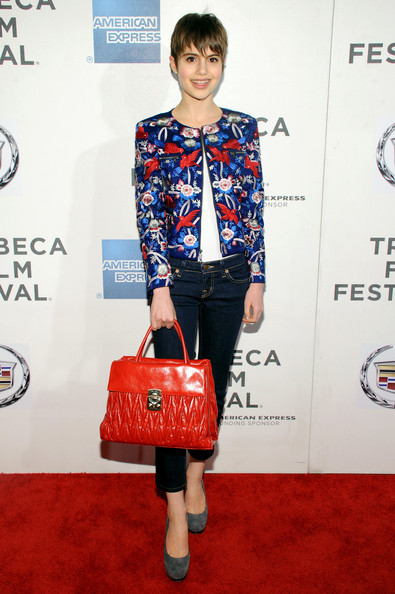 Sami Gayle added an extra dose of color with a bright red leather tote.